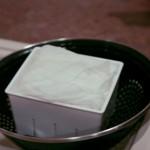 11: Dobre o tecido por cima de tudo, formando um pacotinho